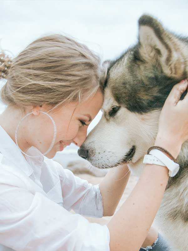 Lady face to face with malamute dog